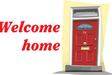 red front door with title welcome home