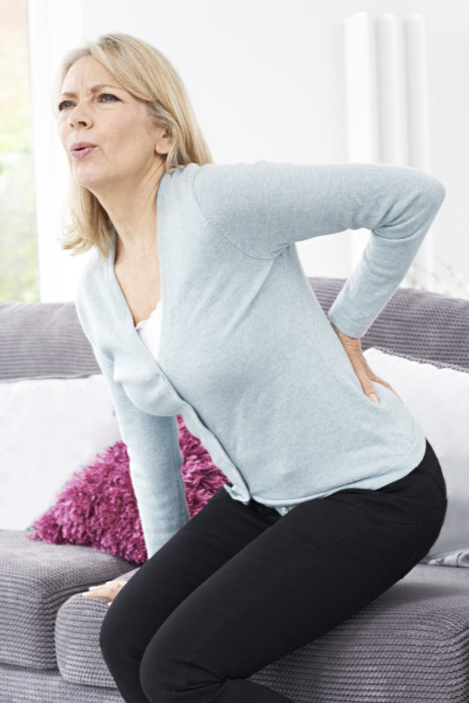 Mature Woman Suffering From Backache At Home