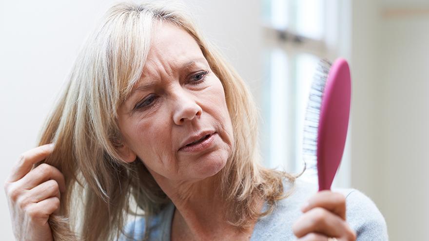Blonde woman brushing her hair