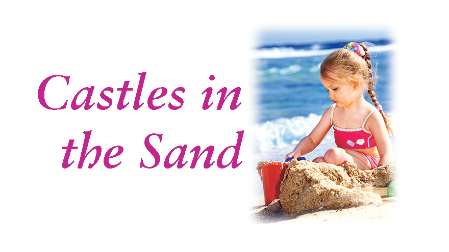 Little girl with sandcastle and title