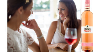 Ladies sharing rose wine Pic: Istockphoto