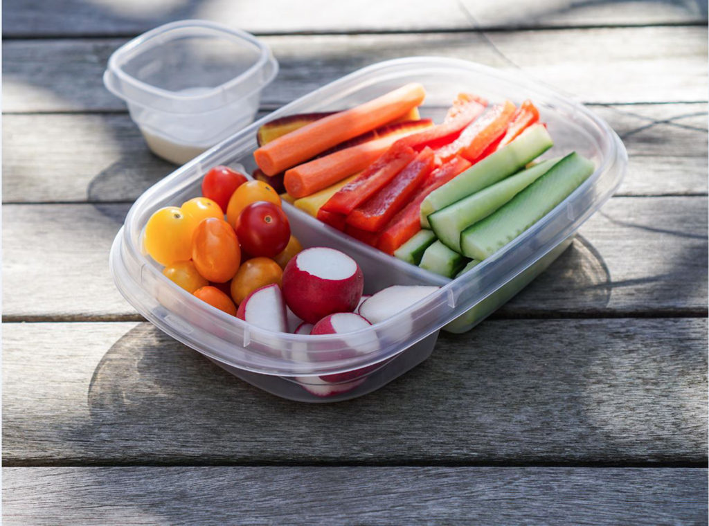 Chopped vegetables in Tupperware dish