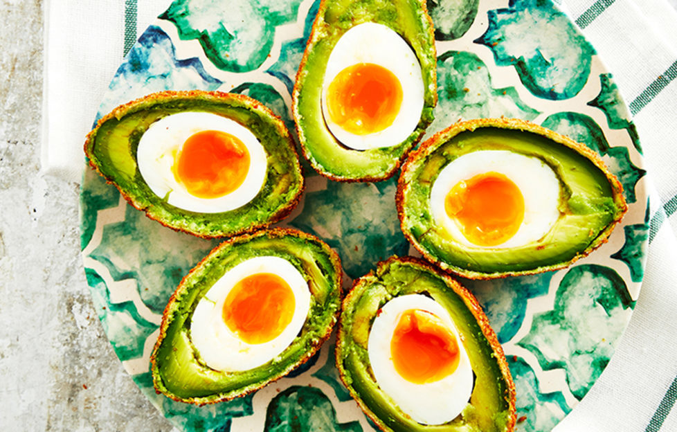 Avocado scotch eggs on a plate