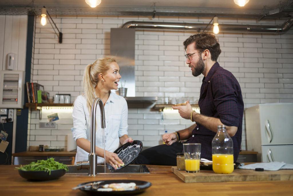 Couple spending time together in kitchen