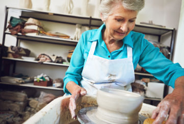 Shot of a senior woman making a ceramic pot in a workshop