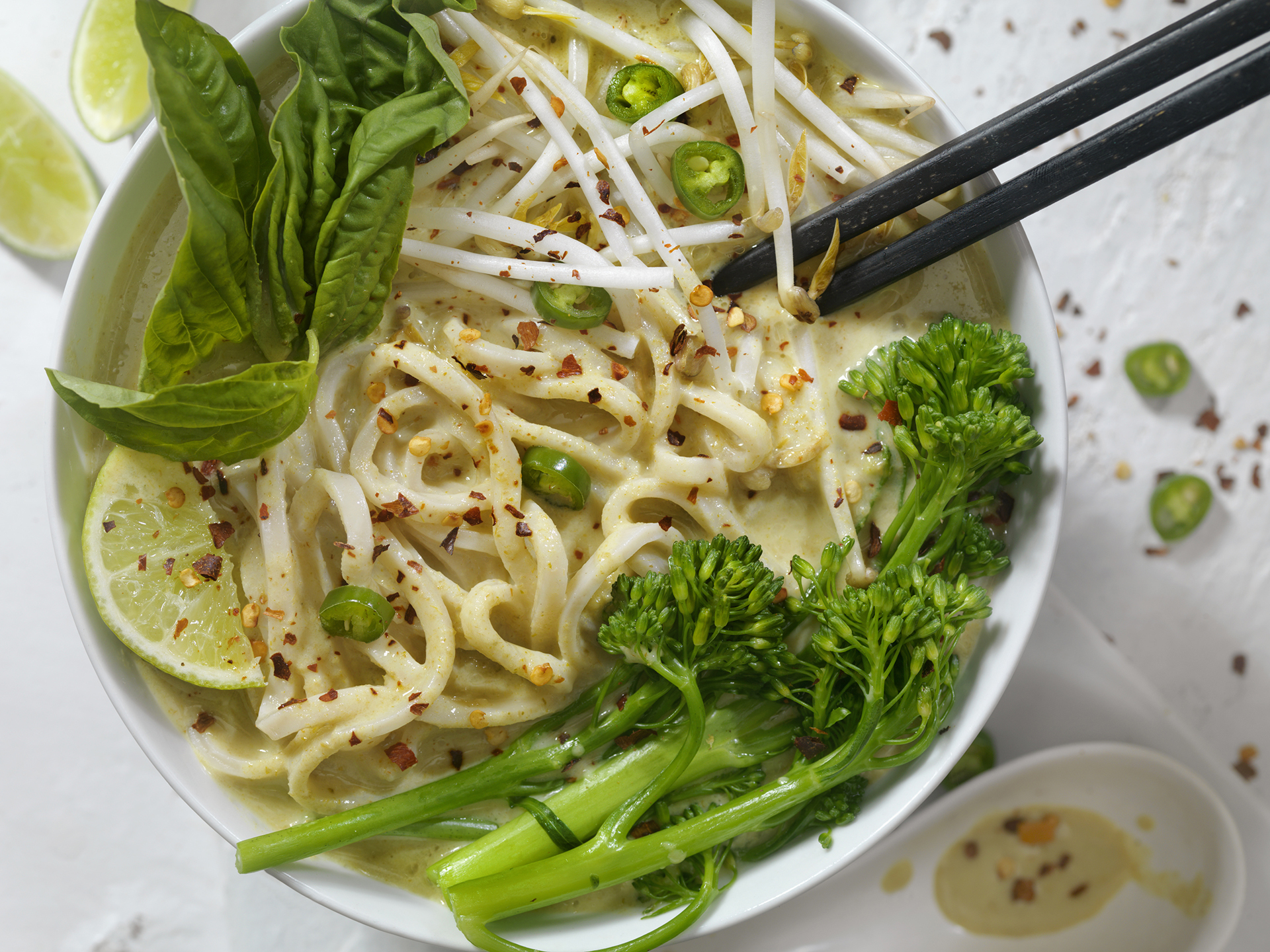 Thai Green Curry Noodle Soup with Broccoli, Bean Sprouts, Fresh Basil, Lime and Chili Flakes