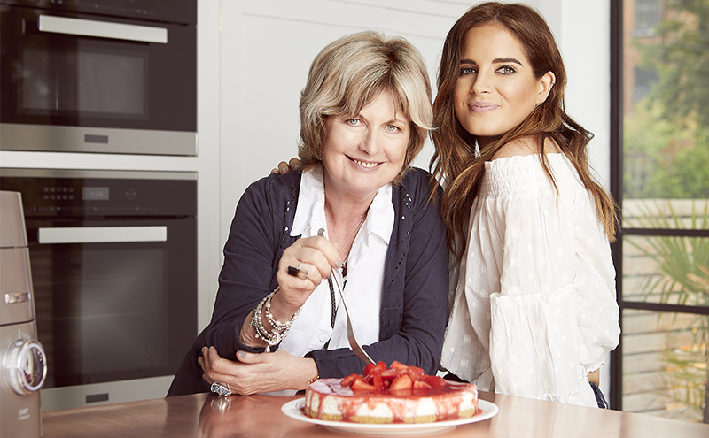 Binky and her mother in the kitchen with a completed cheesecake