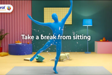 Figure in blue body suit dancing