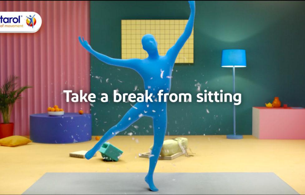 Figure in blue body suit dancing