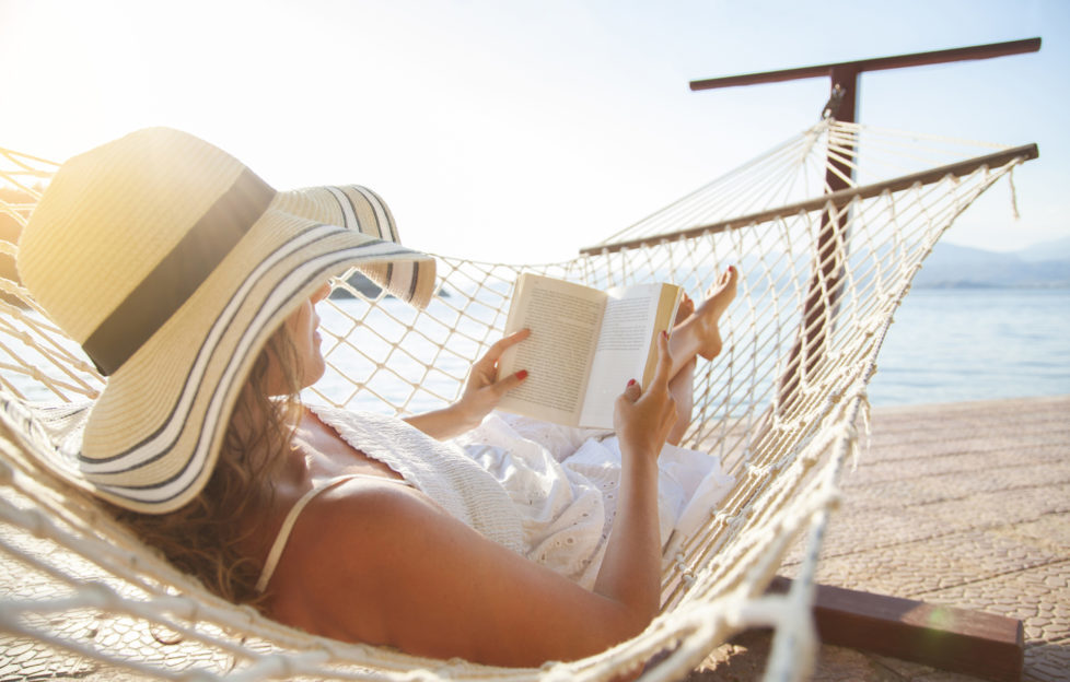 Woman in a hammock with book on summer day Pic: Istockphoto