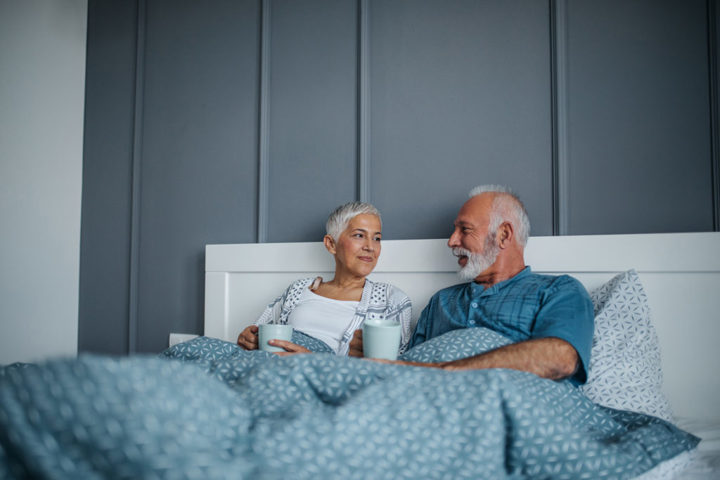 Shot of a mature couple having coffee in bed