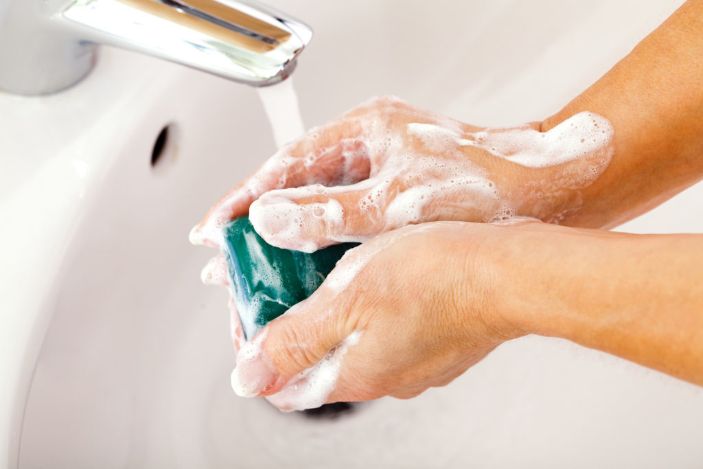Mature woman washing her hands