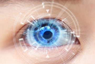 Close-up of woman's blue eye. High Technologies, contact lens
