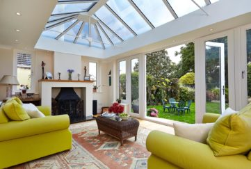 Yellow sofas in conservatory