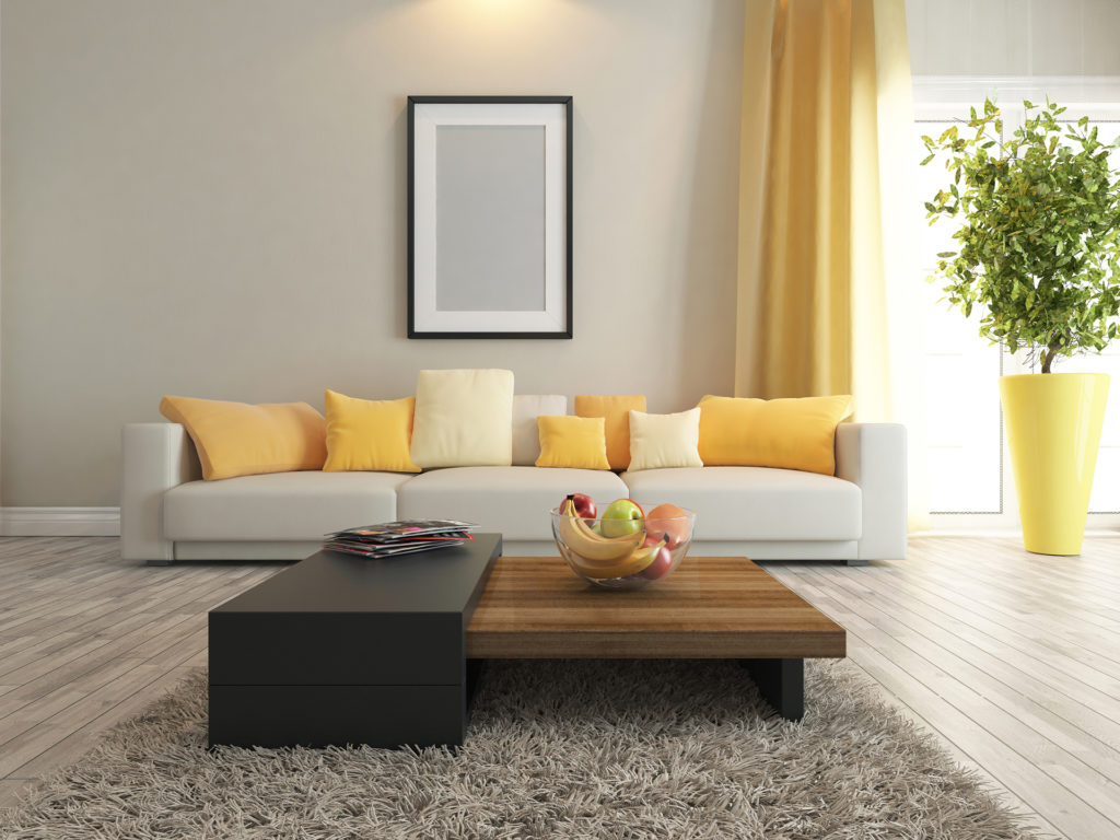 modern interior design living room with yellow curtains, cushions and oversized plant pot Pic: Istockphoto