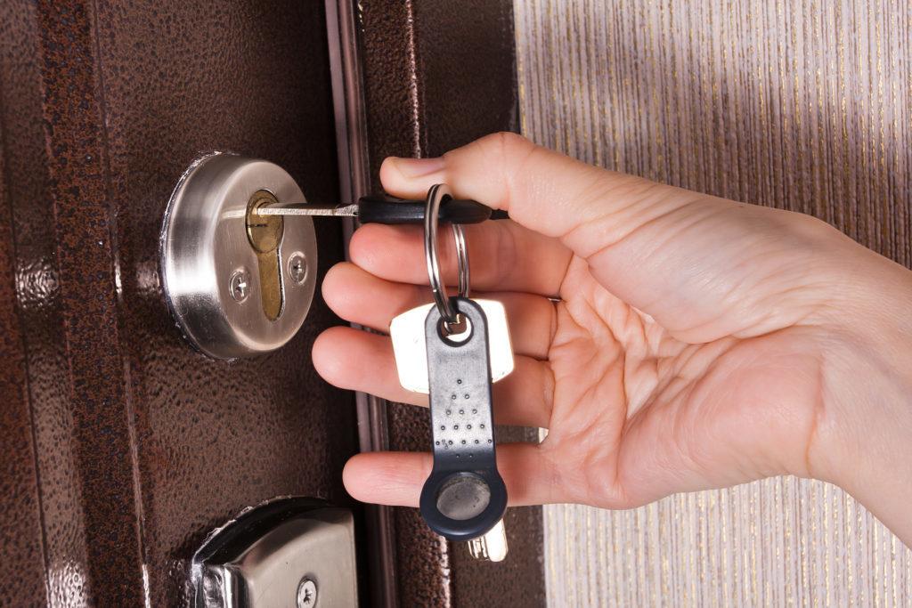 Hand unlocking door - close up