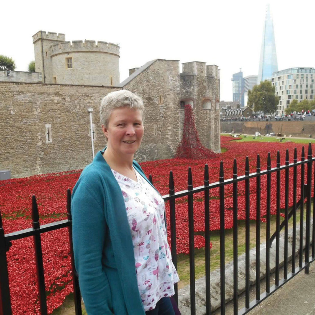 My Weekly staff member Judith in front of the Weeping Window display of ceramic poppies at the Tower of London in 2014
