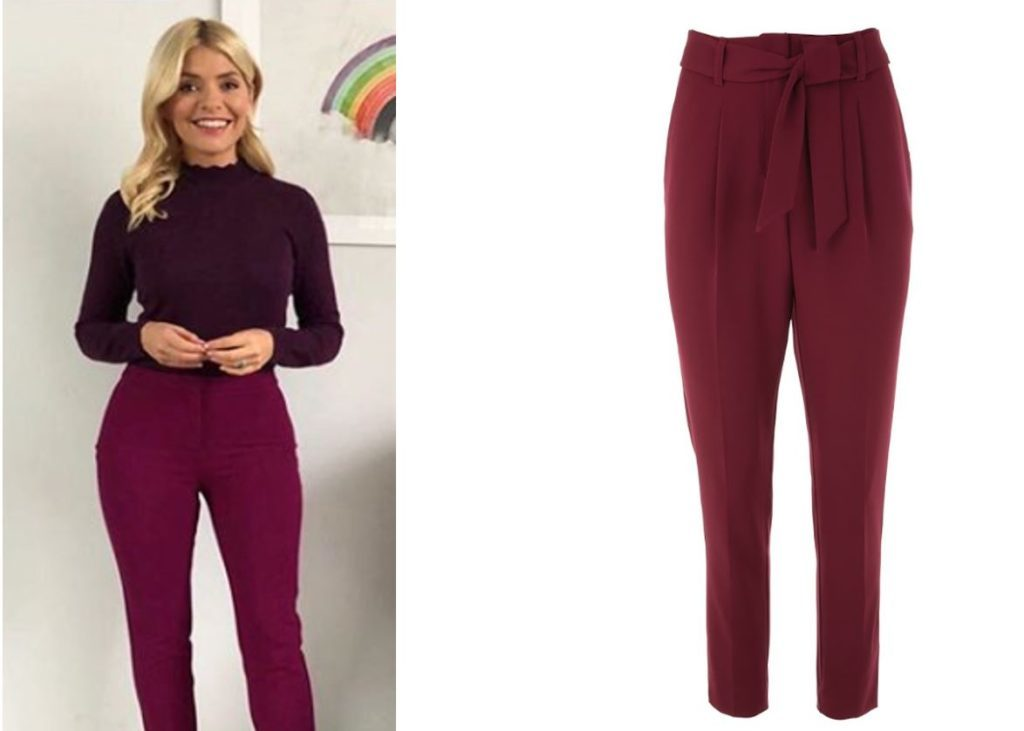 Holly Willoughby in dark red trousers