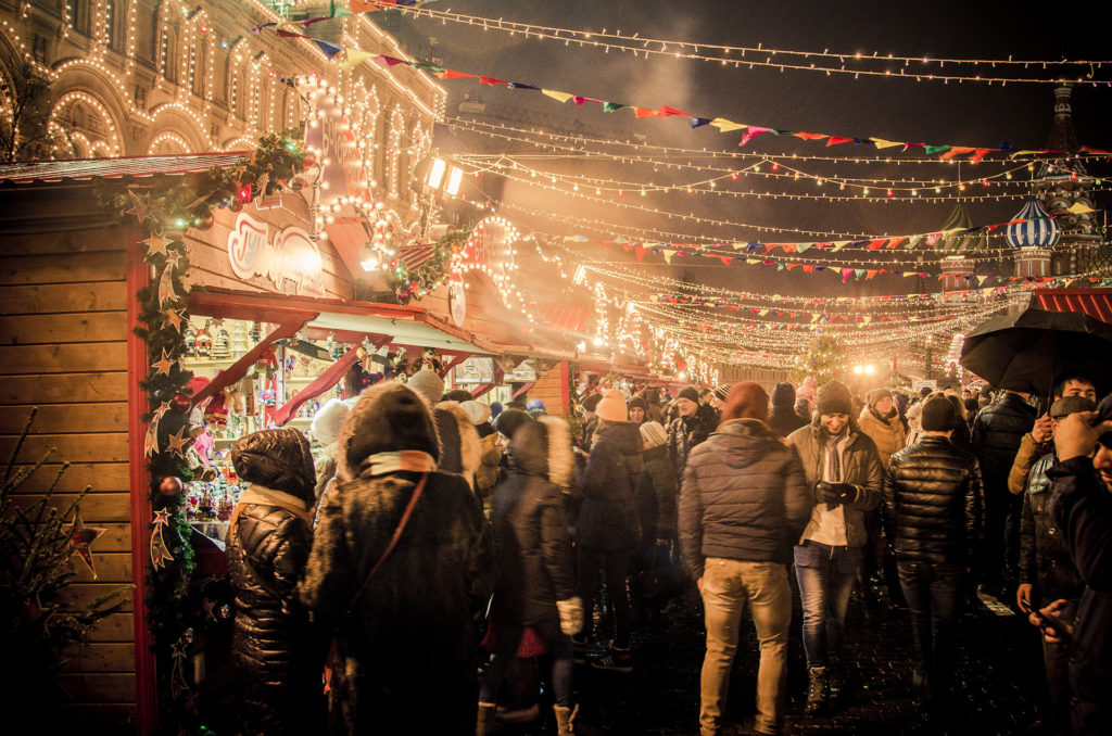People at a night-time Christmas market