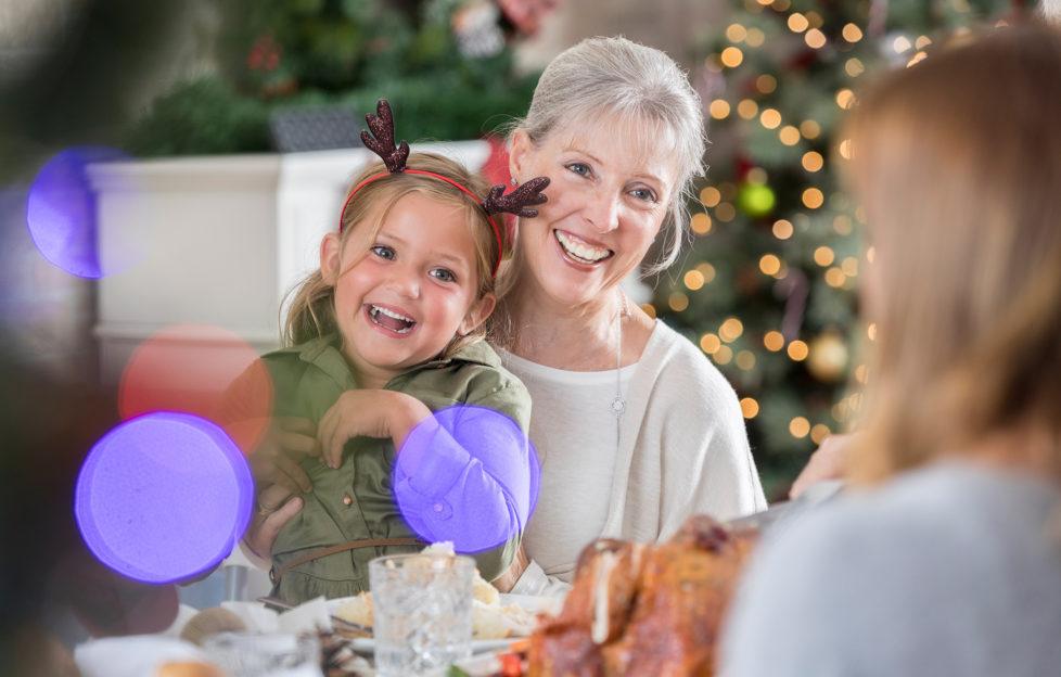 Three generations of women enjoy Christmas dinner