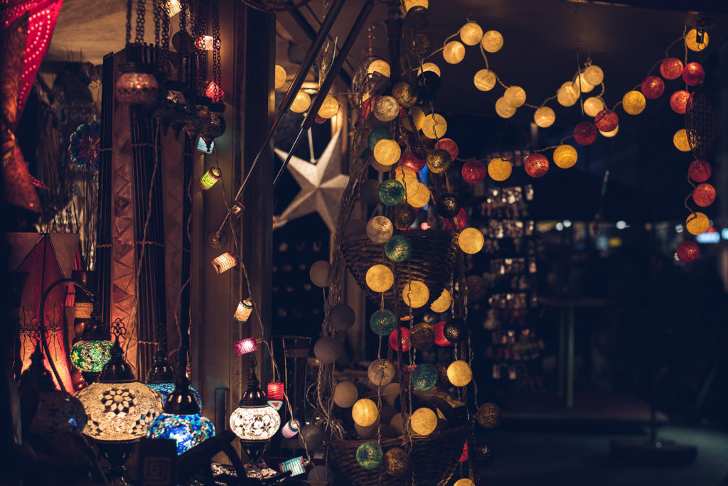 Lights and ornaments at a night-time Christmas market