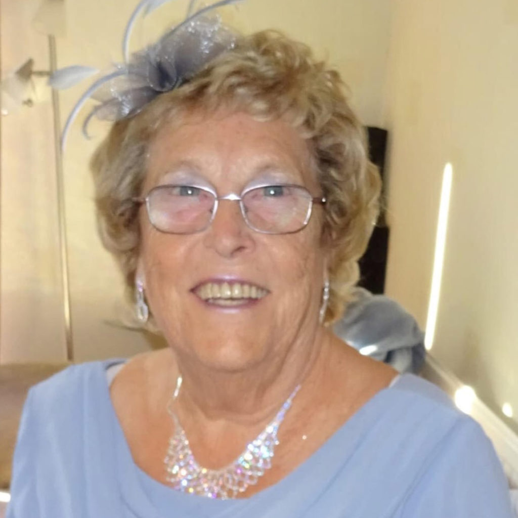 Smiling mature lady in wedding outfit (soft blue dress)