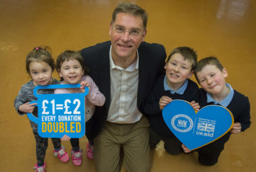 Magnus launches the appeal with a little help from local twins