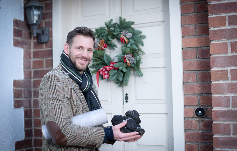 Gavin McDonald from Oban brings the gift of coal to the door practises in a bid by Lidl to bring back the Scottish tradition of first-footing.