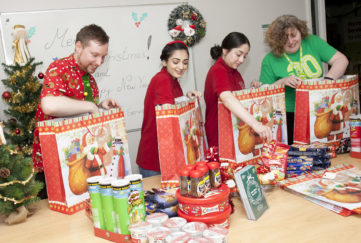Royal Voluntary Service volunteers in Staffordshire package up Christmas hampers to deliver to older people in the community