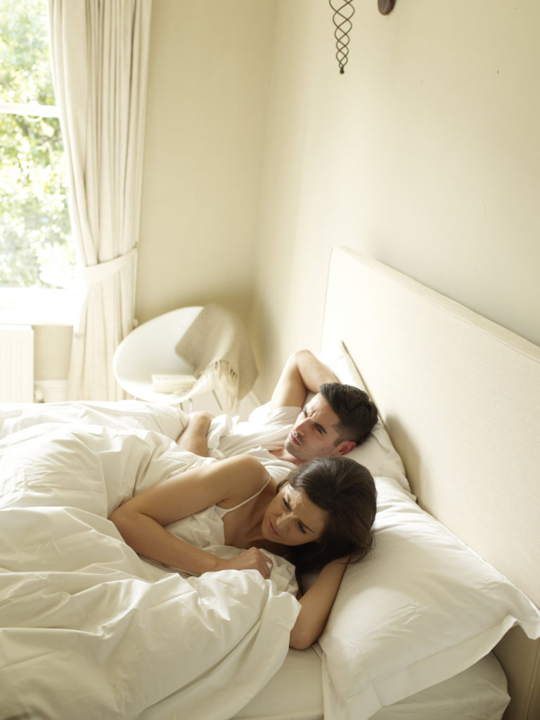 Couple look uncomfortable in double bed