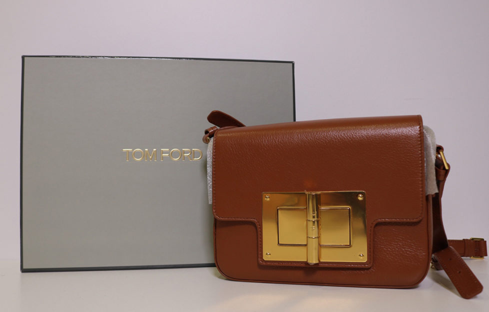 Tom Ford designer handbag, tan, square with large gold coloured hinge style buckle