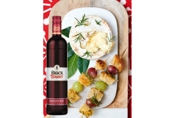 Camembert baked and a bottle of red Black Tower wine