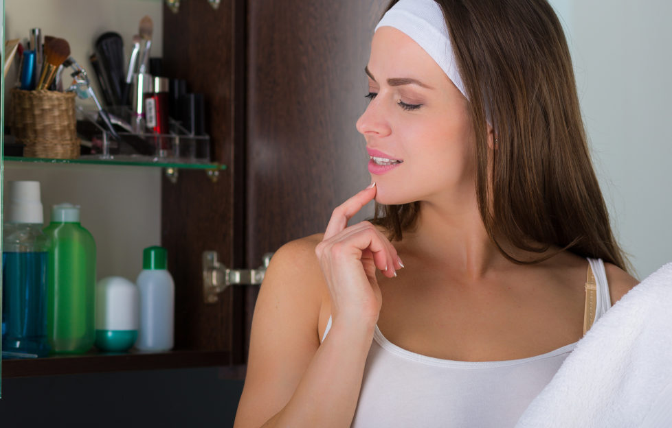 Woman looking in bathroom cabinet Pic: Istockphoto