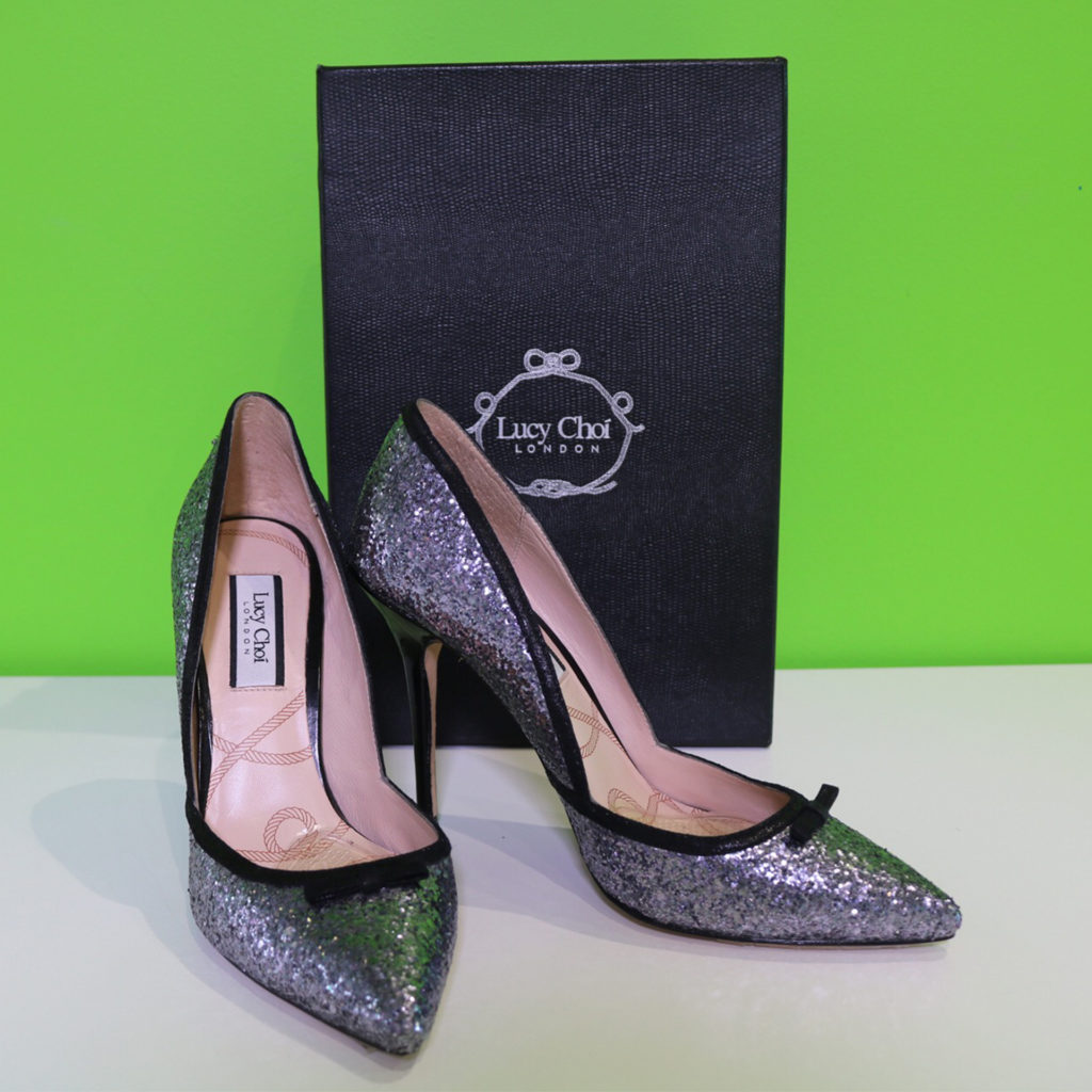 Pair of silver sequined high heeled shoes