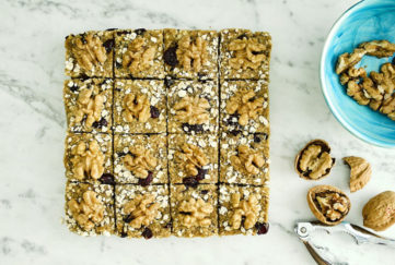Block of raw flapjack, cut into 16, topped with walnuts