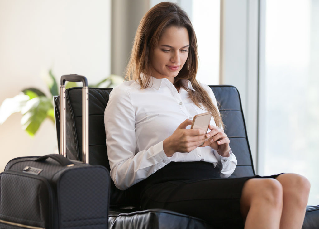Lady keeping up with expenses at airport Pic: Istockphoto