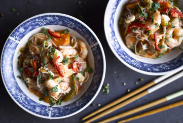 easy laksa with king prawns in blue patterned bowls with chopsticks