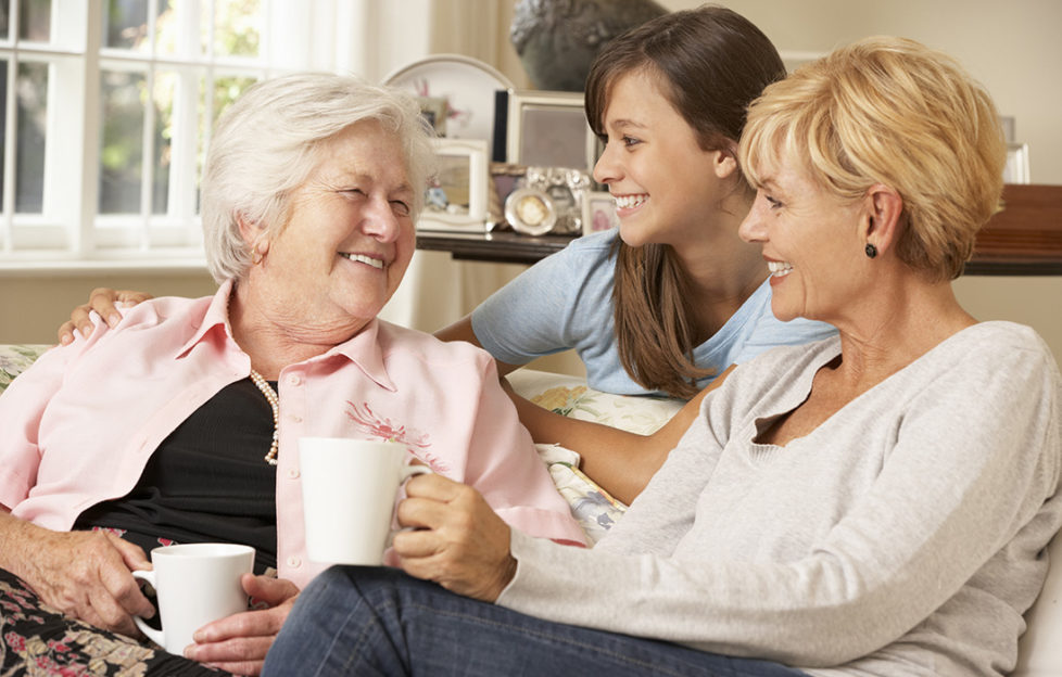 Adult Daughter With Teenage Granddaughter Visiting Grandmother Having A Chat Pic: Istockphoto