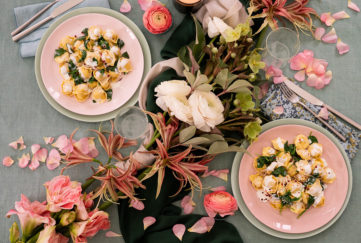 Pasta meal for two with flowers on table