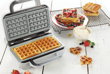 Waffle maker with berries and waffles