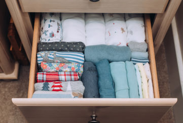 Clothes neatly folded in a drawer
