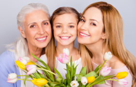 Mum, daughter and granddaughter with spring flowers Pic: Istockphoto