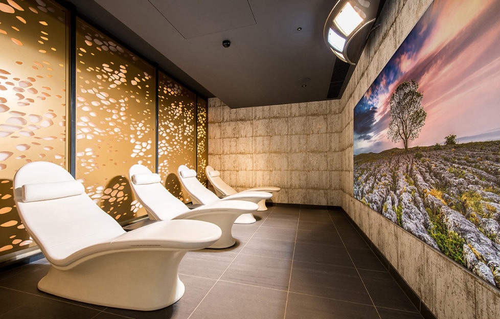 Sunlight therapy at Rudding Park - sunbeds, sun lamps high on wall and beautiful countryside image on the wall