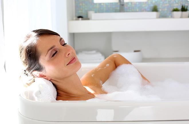 Beautiful woman relaxing in bathtub Pic: Istockphoto