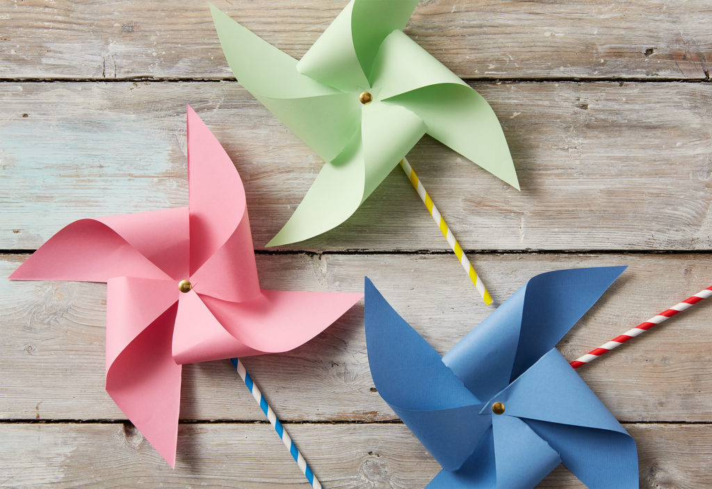 Three finished pinwheels - mini windmills - in pink, green and blue