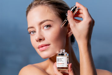 model with facial oil