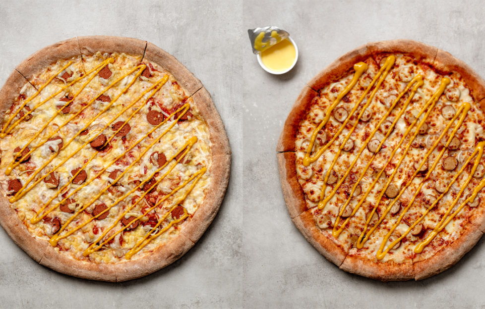 Two hotdog pizzas. The vegan version has pale cheese and reddish hotdog pieces and the regular version has darker toasted cheese and pale pink hotdog pieces