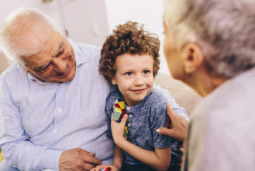 Young boy with his grandparents Pic: Istockphoto