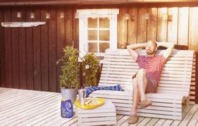 Man sitting on white bench in garden