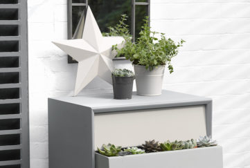 Chest of drawers painted in shades of grey and white